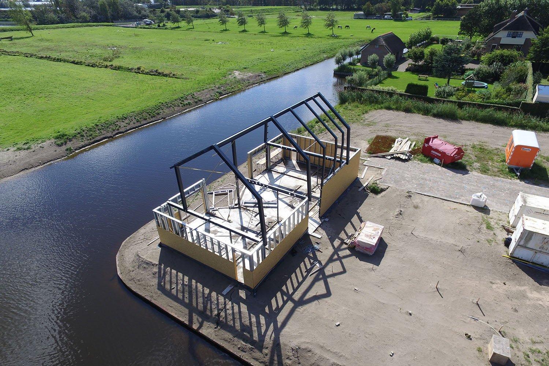 Laat een luchtfoto maken van de bouw van je woning.