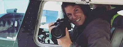 Luchtfotograaf vanuit een vliegtuig